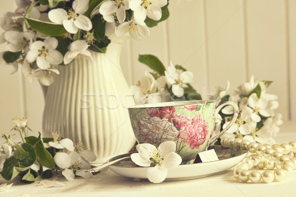 Stock photo: Tea cup with apple blossoms on table