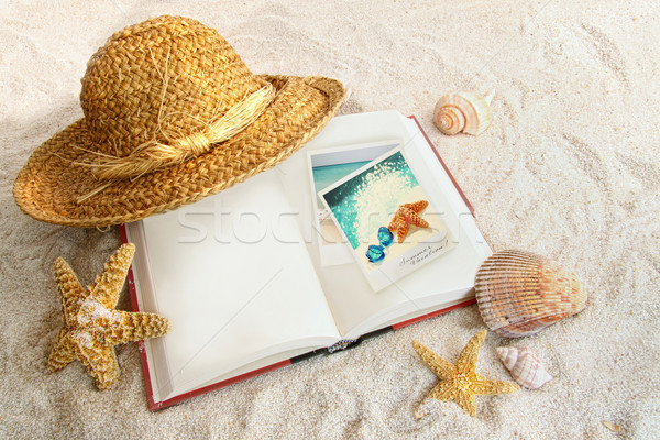 Book with straw hat and seashells in sand Stock photo © Sandralise