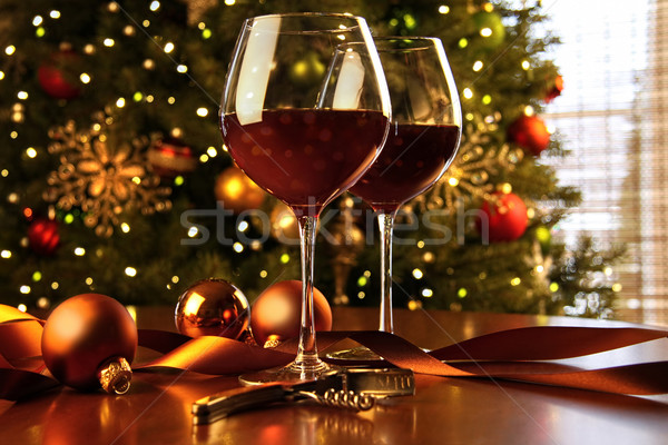 Red wine on table Christmas tree Stock photo © Sandralise