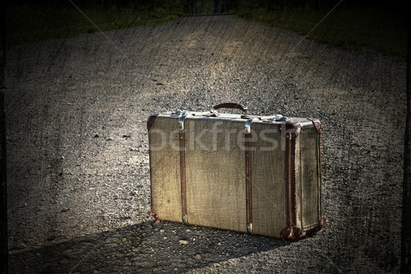 Old suitcase left on a dirt road Stock photo © Sandralise