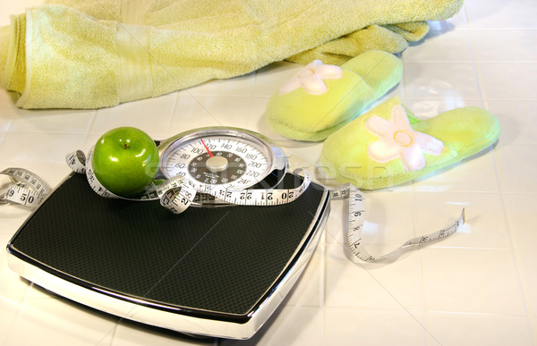 Weight scale on tile floor with towel and slippers Stock photo © Sandralise