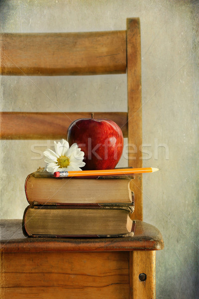 Apple and books on old school chair Stock photo © Sandralise