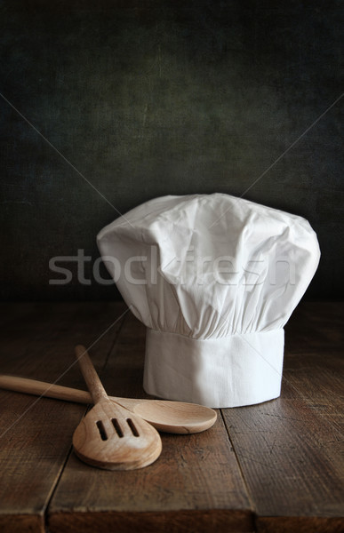 Stock photo: Chef hat and wodden spoons on wood