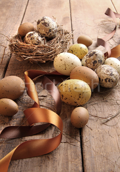 Brown and yellow eggs with ribbons for easter Stock photo © Sandralise
