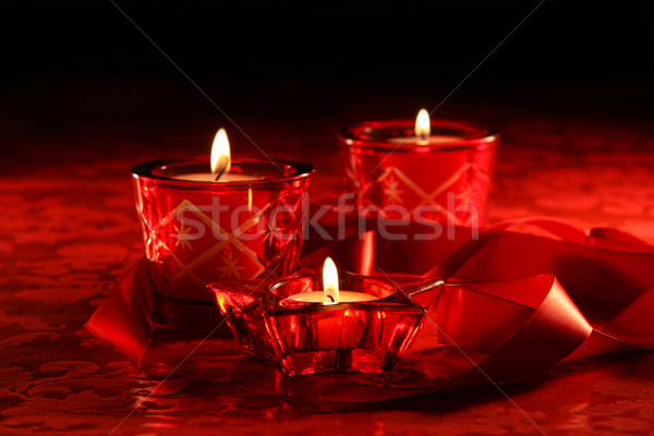 Votive candles on dark red background Stock photo © Sandralise