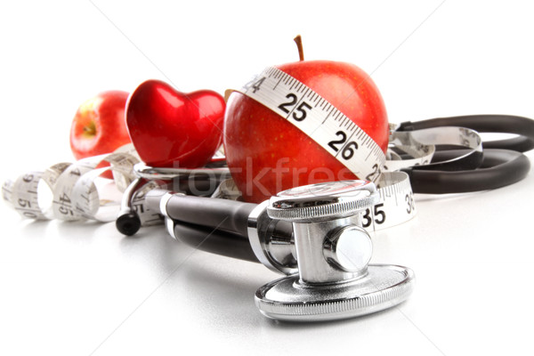 Stethoscope with red apples on a white  Stock photo © Sandralise