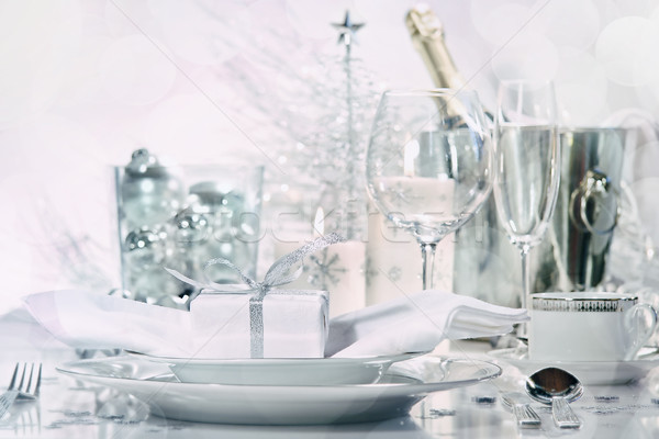 Holiday place setting with glasses and champagne Stock photo © Sandralise