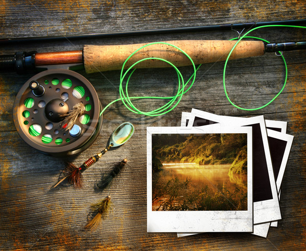 Stock photo: Fly fishing rod with polaroids pictures on wood