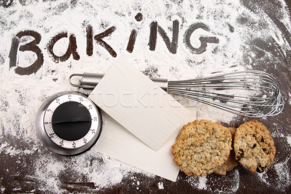 Stock photo: Word baking written in flour and cooking utensils on wooden tabl