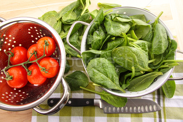 Fresh spinach leaves with tomatoes  Stock photo © Sandralise