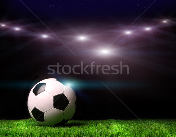 Soccer ball on grass against black Stock photo © Sandralise