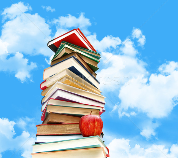 Pile of books and apple against blue sky Stock photo © Sandralise