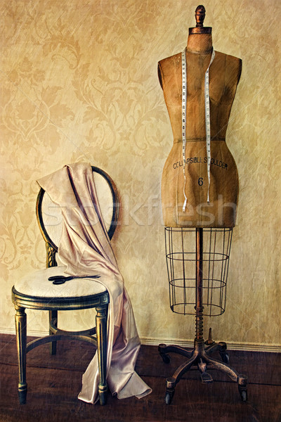 Antique dress form and chair with vintage feeling Stock photo © Sandralise
