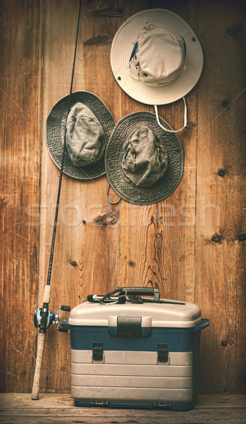Hats hanging on wall with fishing equipment Stock photo © Sandralise