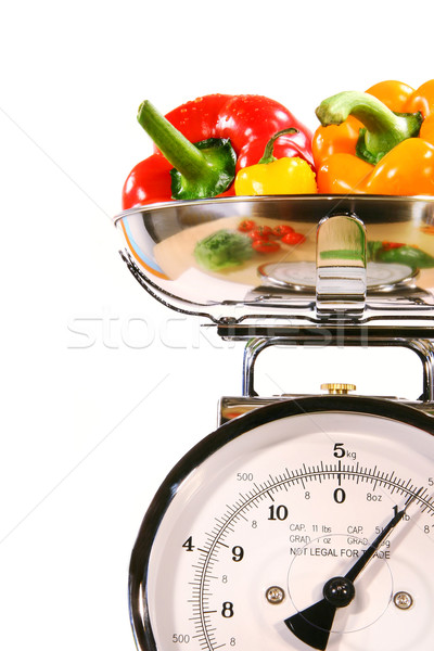 Closeup of kitchen scale with colored peppers Stock photo © Sandralise