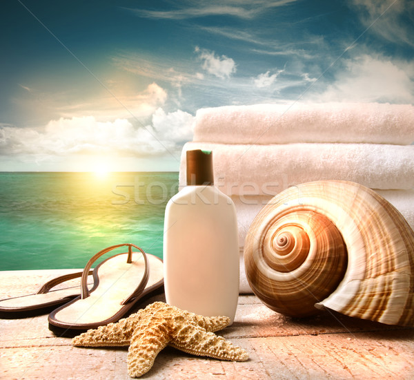 Sunblock lotion and towels and ocean scene Stock photo © Sandralise