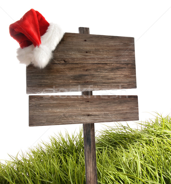 Weathered wooden sign with santa hat on white  Stock photo © Sandralise
