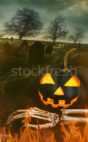Black pumpkin with skeleton hand with graveyard Stock photo © Sandralise