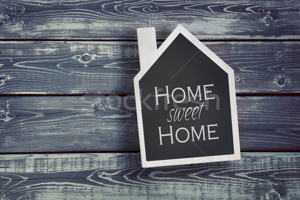 House shaped chalkboard on wooden background Stock photo © Sandralise
