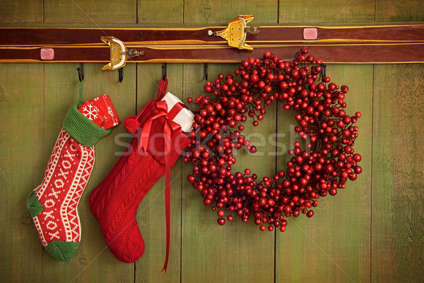 Christmas stockings and wreath hanging on  wall Stock photo © Sandralise