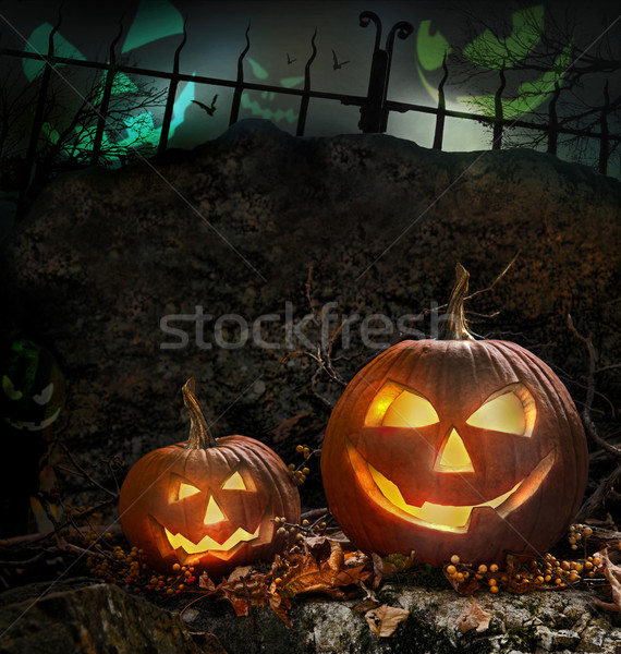 Stock photo: Halloween pumpkins on rocks  at night