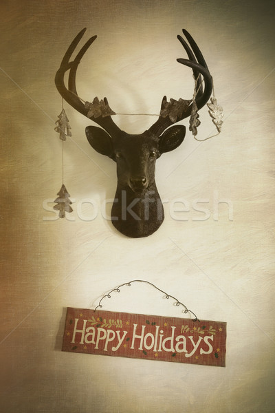 Mounted deer head with garland and holiday sign Stock photo © Sandralise