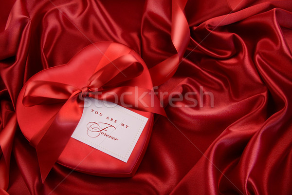 Box of chocolate with red ribbon Stock photo © Sandralise