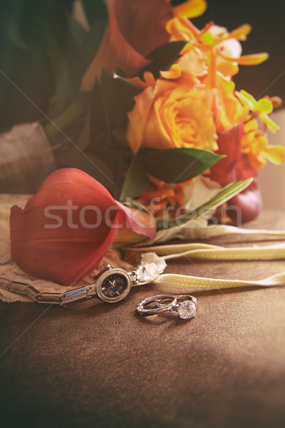 Wedding rings and bouquet on chair Stock photo © Sandralise