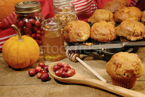 Freshly made pumpkin and berry muffins Stock photo © Sandralise