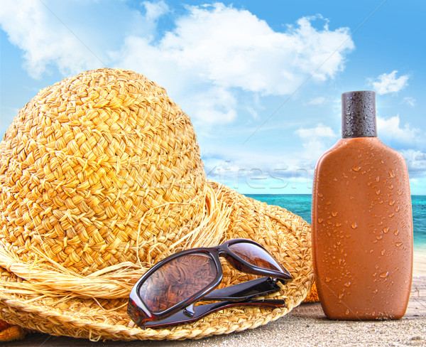 Beach items and suntan lotion at the beach Stock photo © Sandralise
