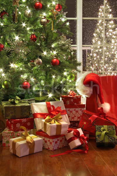 Brightly lit christmas tree with lots of gifts Stock photo © Sandralise