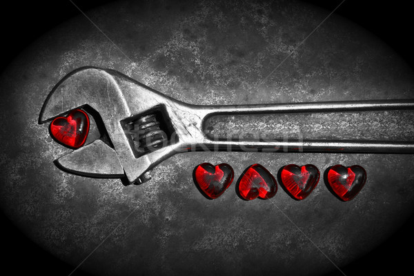 Five grunge hearts with wrench on rusty background/ BW  Stock photo © Sandralise