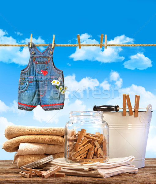 Laundry day with towels, clothespins on table against blue sky  Stock photo © Sandralise