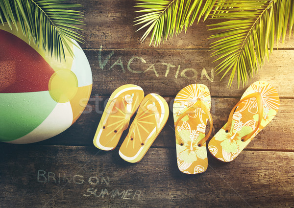 Summer sandals with beach ball on wood background Stock photo © Sandralise