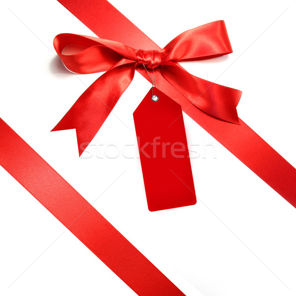 Stock photo: Holiday red bow islotaed on white background