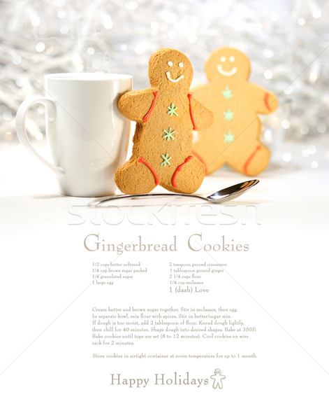 Hot holiday drink with gingerbread cookies on festive cookie recipe Stock photo © Sandralise