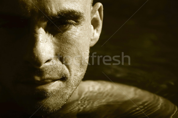 Swimmer in water concentrating/ Sepia tone Stock photo © Sandralise