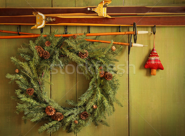 Old pair of skis hanging with wreath  Stock photo © Sandralise