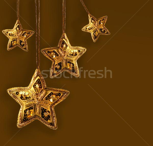 Gold beaded stars isolated on white Stock photo © Sandralise