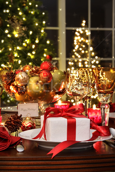 Stock photo: Festive table setting with red ribboned gift