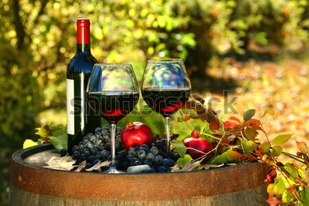 Glasses of red wine on old barrel Stock photo © Sandralise