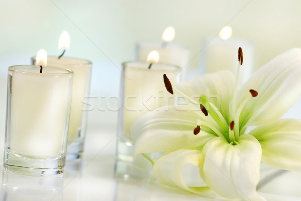 Lily flower with candle Stock photo © Sandralise