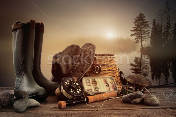 Fly fishing equipment on deck with view of a misty lake Stock photo © Sandralise