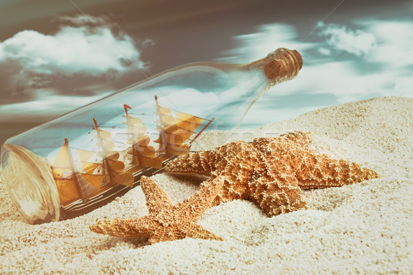 Botella buque dentro playa estrellas de mar agua Foto stock © Sandralise