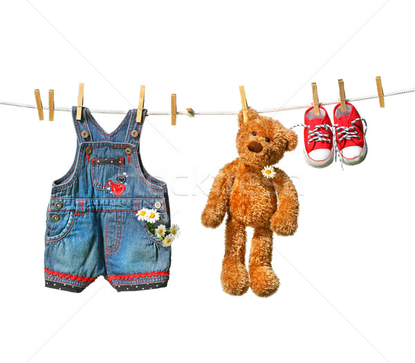 Children's clothes with teddy bear on clothesline Stock photo © Sandralise