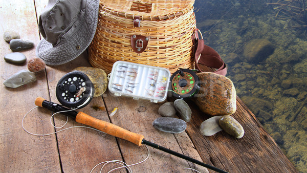 Fishing lures,reel,and sun hat Stock photo © Sandralise