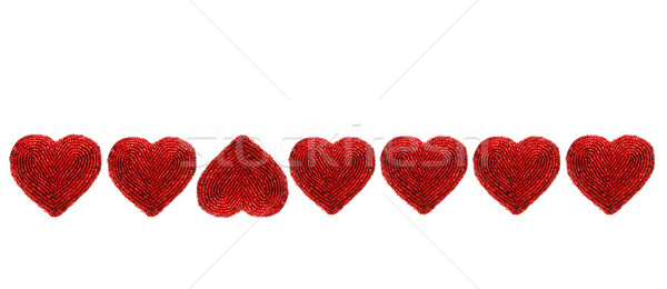 Red beaded hearts isolated against white Stock photo © Sandralise