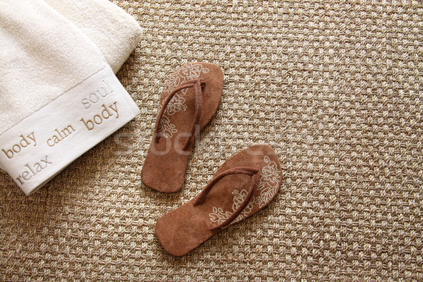 Flip flops with towels on seagrass rug Stock photo © Sandralise