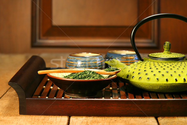 Green cast iron teapot Stock photo © Sandralise