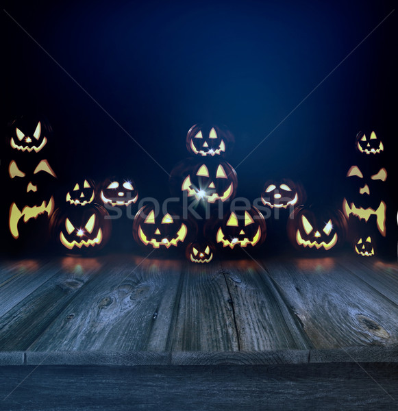 Halloween pumpkins in a dark background and wood floor Stock photo © Sandralise